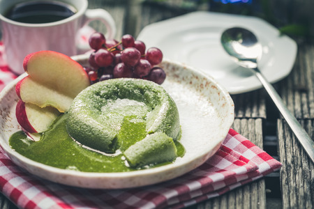 friut: Green tea cake with friut in palte  on wooden