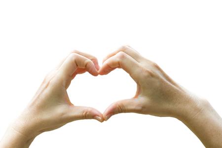 heart symbol: women hands in shape of heart on white background Stock Photo