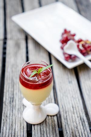 cotta: Dessert panna cotta with stawberry jam Stock Photo