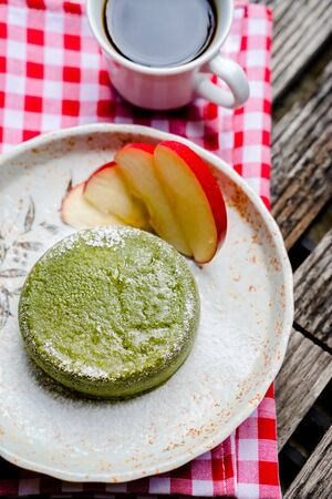 friut: Green tea cake with friut in palte on wooden Stock Photo