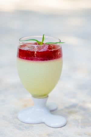 panna: Dessert panna cotta with stawberry jam Stock Photo