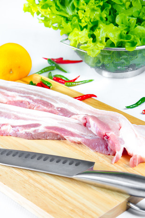 streaky: streaky pork with knife on wooden boards Stock Photo
