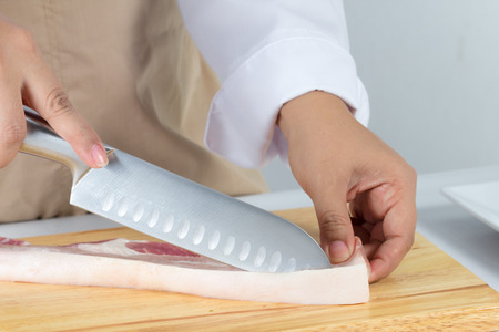 streaky: chef sliced streaky pork on cutting boards