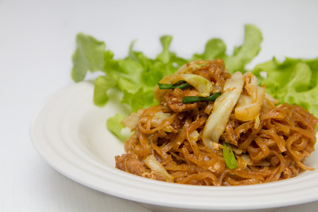 fried noodle: chef making fried noodle in white plate Stock Photo
