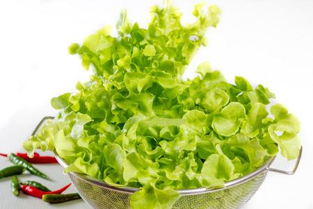 lettuces: fresh lettuces in wooden bowl Stock Photo