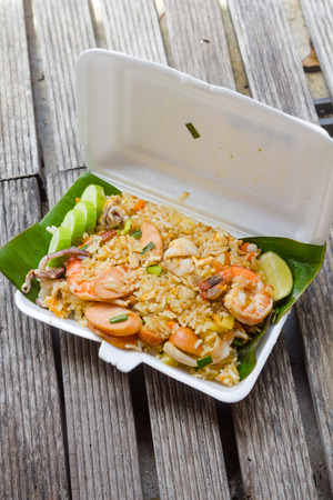 foam box: fried rice with shrimp, squid and sausage in the foam box Stock Photo