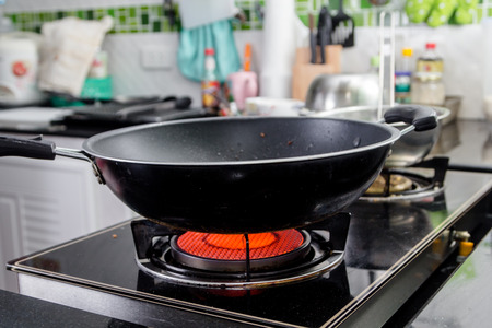 Black frying pan on gas stove Stock Photo