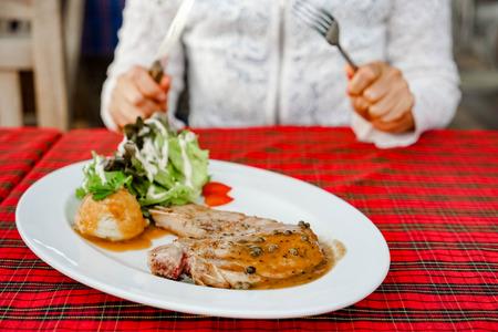 mutton chops: close up Pork chop steak in steak shop