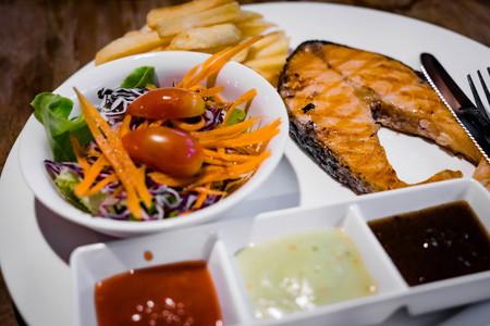 close up salmon steak with salad