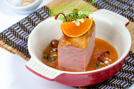 Ham with Orange  Sauce On Dining Table Stock Photo