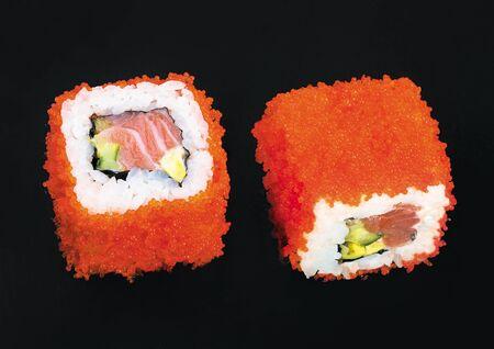 Salmon tobiko rolls on a black background Stock Photo - 94266102