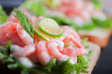 Sandwich with shrimps, with mayonnaise and greens