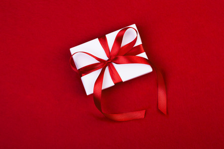 white gift boxes on red background
