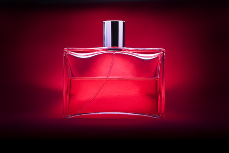 perfume bottle on a red background