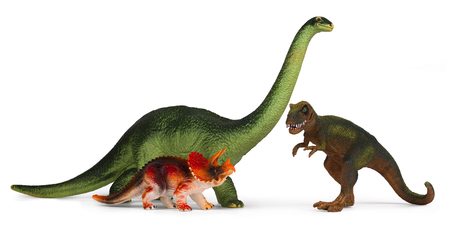 Green dinosaur diplodoc and tyrannosaurus rex plastic toy models isolated on white background
