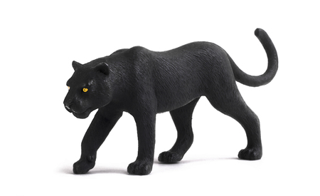 Miniature model of a black panther isolated on a white background