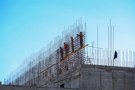 A group of workers working on the construction of a house Standard-Bild - 151236922