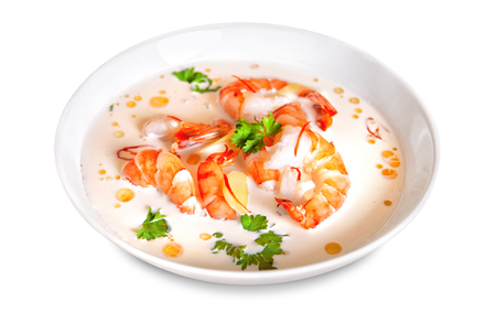 Traditional Thai seafood soup tom-yum in a white plate isolated on white background