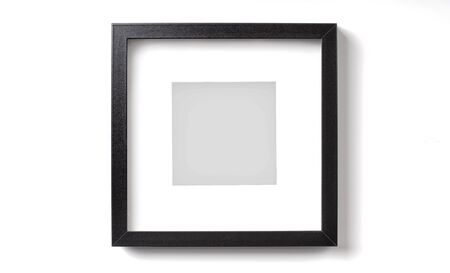 Black square picture frame with shadow on the white wall
