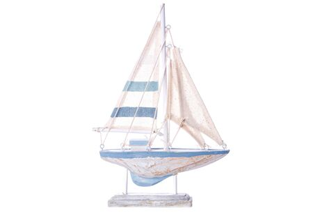 Antique wooden table sailing yacht toy statuette isolated on white background 写真素材