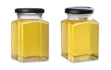 Mockup glass jar of fresh flower honey Isolated on a white background Stock Photo