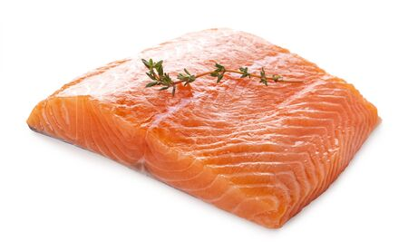 Fresh raw salmon filet with thyme sprig. Isolated on white background.