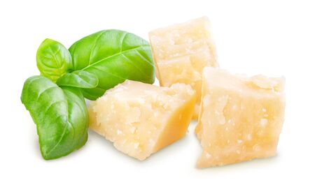 Three slices of permesan reggiano and basil bush isolated on white background, macro shooting, front view Stockfoto