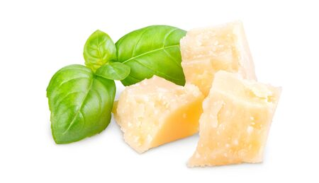 Three slices of permesan reggiano and basil bush isolated on white background, macro shooting, front view Standard-Bild