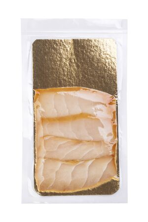 Slices of white fish in transparent vacuum packaging isolated on white background