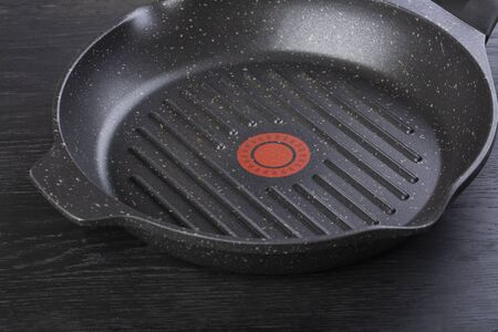 Striped black steak pan isolated on black background Standard-Bild - 150411235