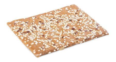 One brown sesame cracker isolated on white background
