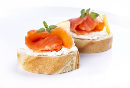 Mini salmon sandwiches isolated on a white background Standard-Bild - 150411577