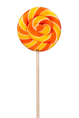 Twisted sweet yellow lollipop isolated on white background Standard-Bild