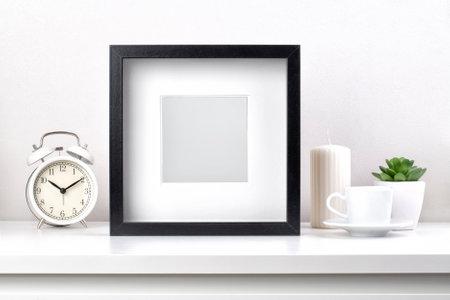 Black modern square photo frame on white table