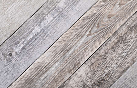 Close up texture background of a fragment of an old gray fence boards