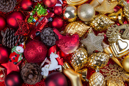 Background of gold and red retro Christmas toys. Top view
