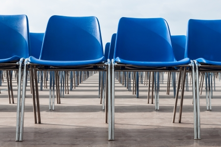 lined up: Blue empty chairs lined up