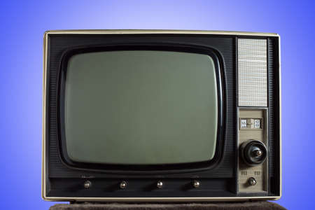 vintage television on blue background photo