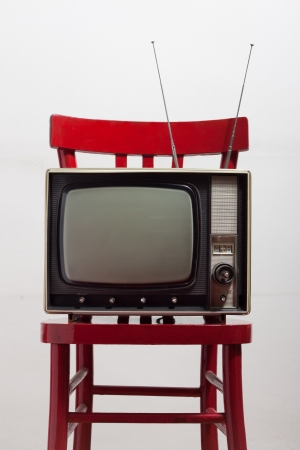 vintage television on a red chair photo