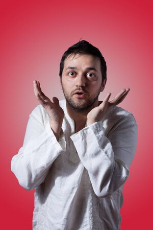Young bearded man expressing with his hands on red background Stock Photo - 17538839