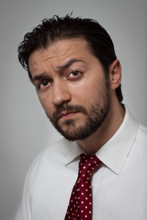Portrait of a young bearded man with red tie