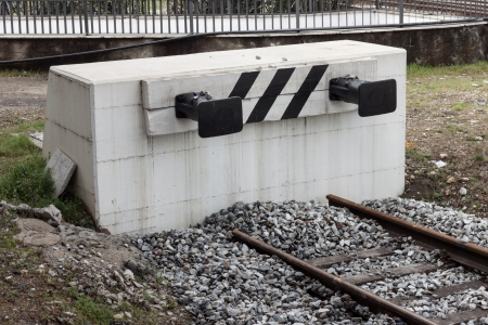 Dead-end track with buffer on a concrete structure Stock Photo