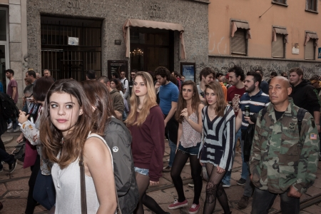 demonstrators: MILAN, ITALY - MAY 1: People march in the streets for the traditional May Day parade in Milan on May 1, 2013