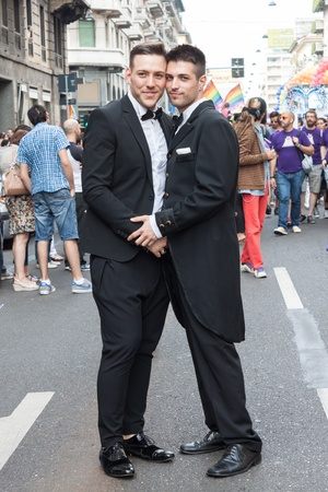 MILAN, ITALY - JUNE 29: Thousands of people march in the city streets for the annual gay pride parade, claiming equality and legal rights in Milan on JUNE 29, 2013