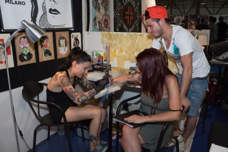 tattoed: MILAN, ITALY - JUlY 6: People visit Tatuami, important event dedicated to the world of tattoos in Milan on JUlY 6, 2013 Editorial