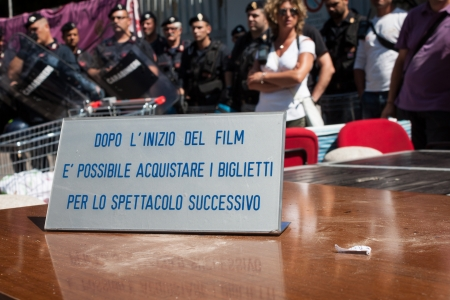 occupy movement: MILAN, ITALY - JULY 23: Riot police evacuates activists from occupied Maestoso movie theater, empty since 2007, in Milan on JULY 23, 2013