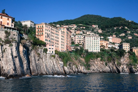 overhanging: Houses built on the rocks overhanging sea in Liguria, Italy Stock Photo
