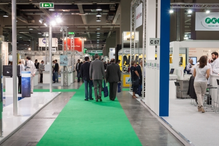 MILAN, ITALY - SEPTEMBER 26  People visit Chem-Med exhibition, complete showcase of equipment and instrumentation for chemical laboratory as well as process technologies for chemical industry in Milan on September 26, 2013
