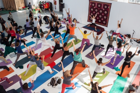 MILAN, ITALY - OCTOBER 11  People take a class at Yoga Festival 2013, event dedicated to yoga, meditation and healthy lifestyle on OCTOBER 11, 2013 in Milan