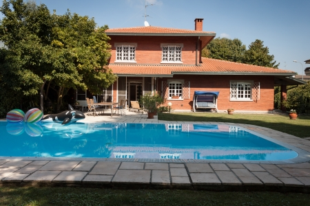 Exterior of a nice villa with garden and swimming pool